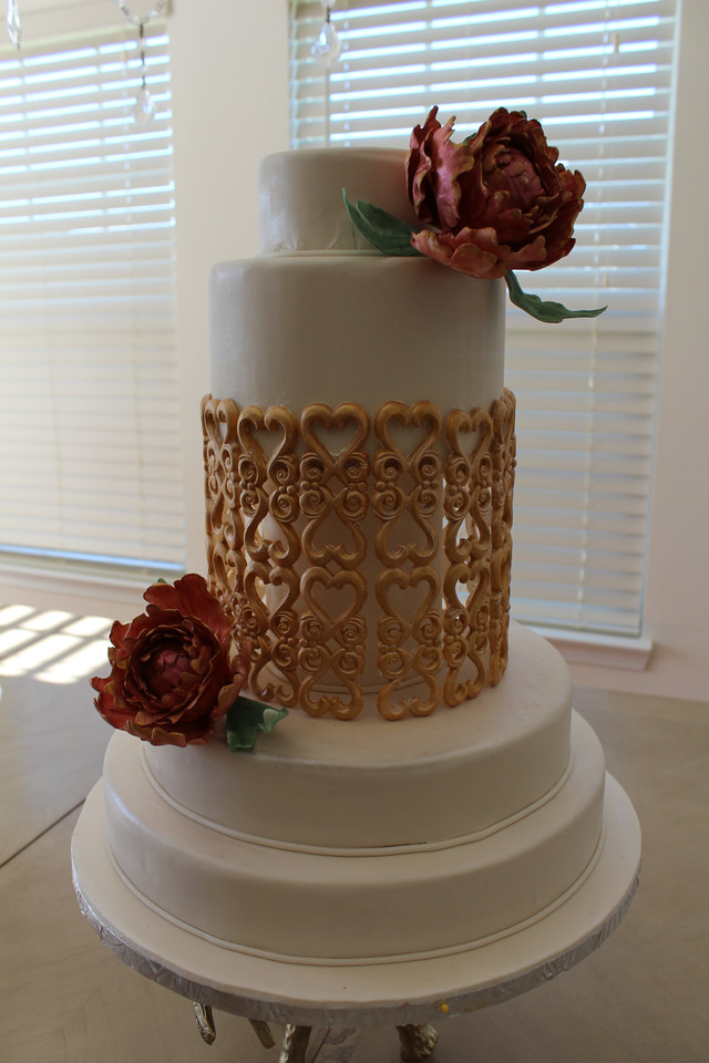 Gold Cage Wedding Cake with Sugar flowers