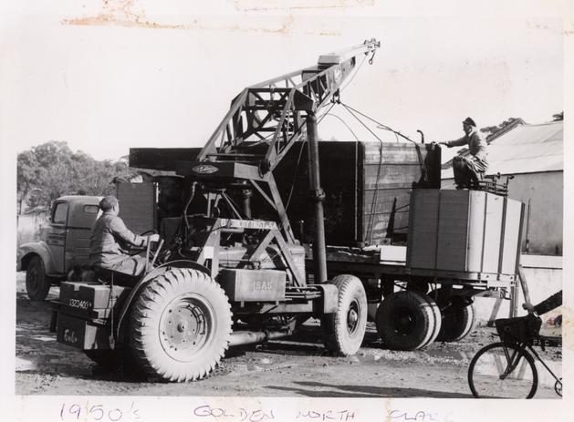 Mobile crane loading truck Golden North