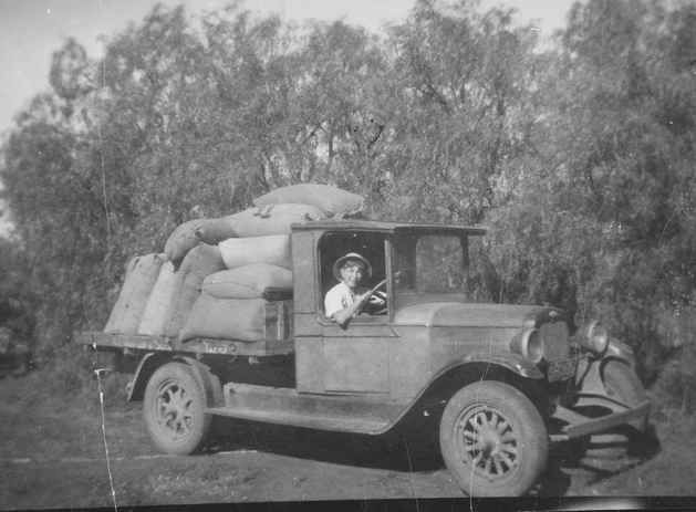 Old Ute loaded with grain bags