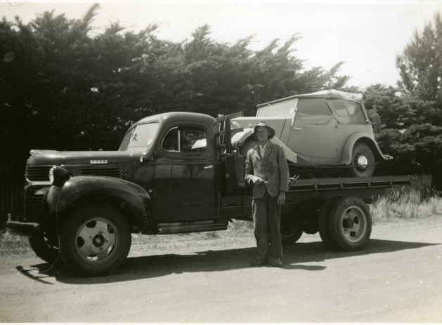 Truck loaded with small sedan Picture146