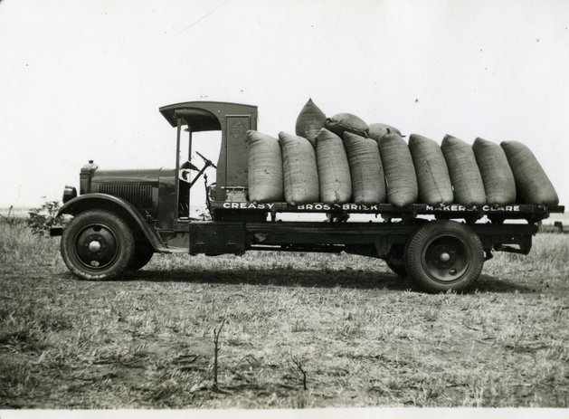 Load of Wheat bags on Speed Wagon
