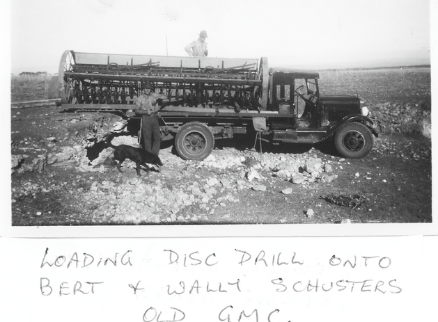 Loading Disc Drill onto old GMC Picture7