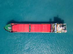 Large Bulk carrier vessel at the Mediterranean sea - Top down aerial image