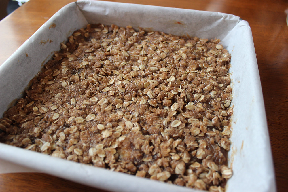 final oat layer spread out, ready to be baked