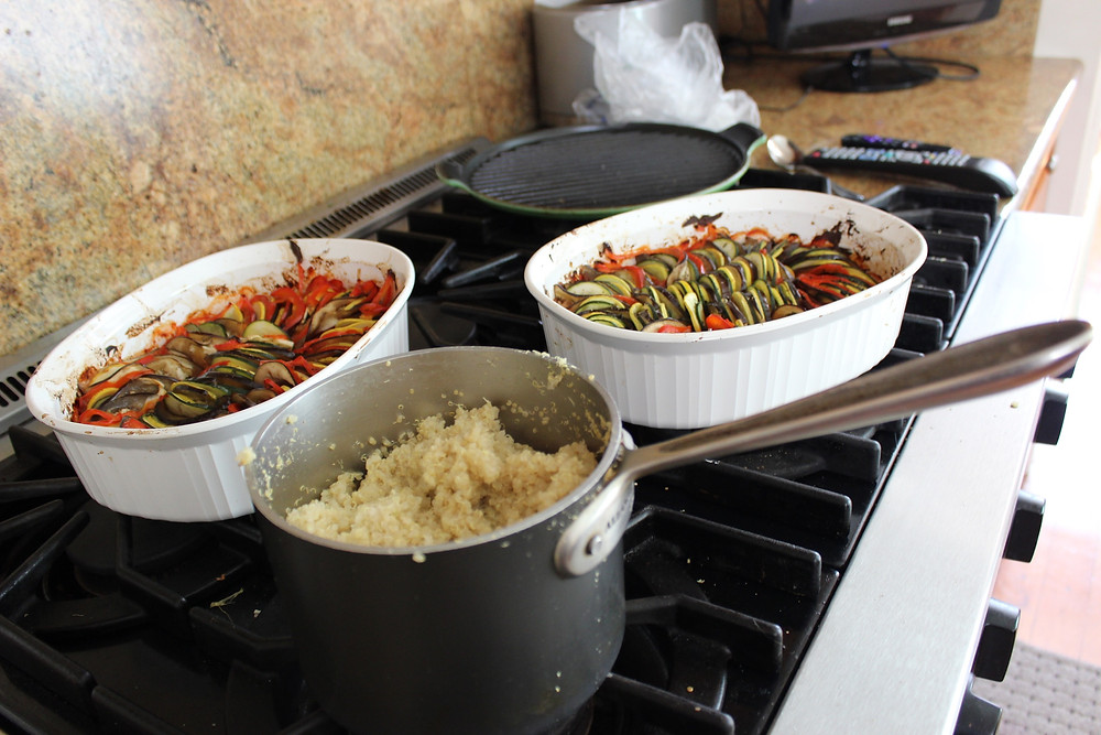 two pans of ratatouille and quinoa