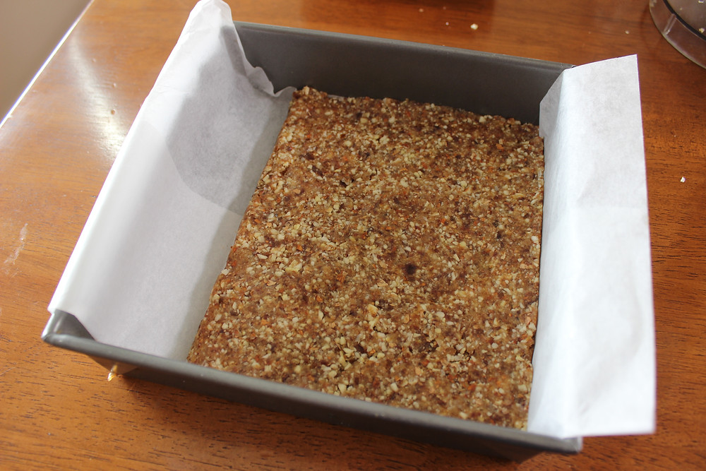 pressing mixture into pan