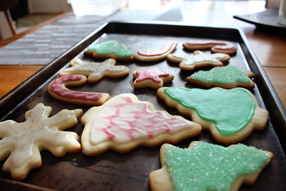 eda's sugar cookies iced and topped with sprinkles