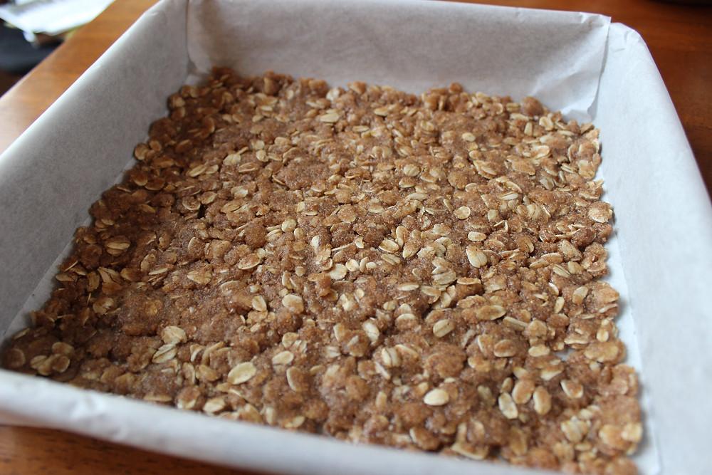 1/2 oat mixture on bottom of pan