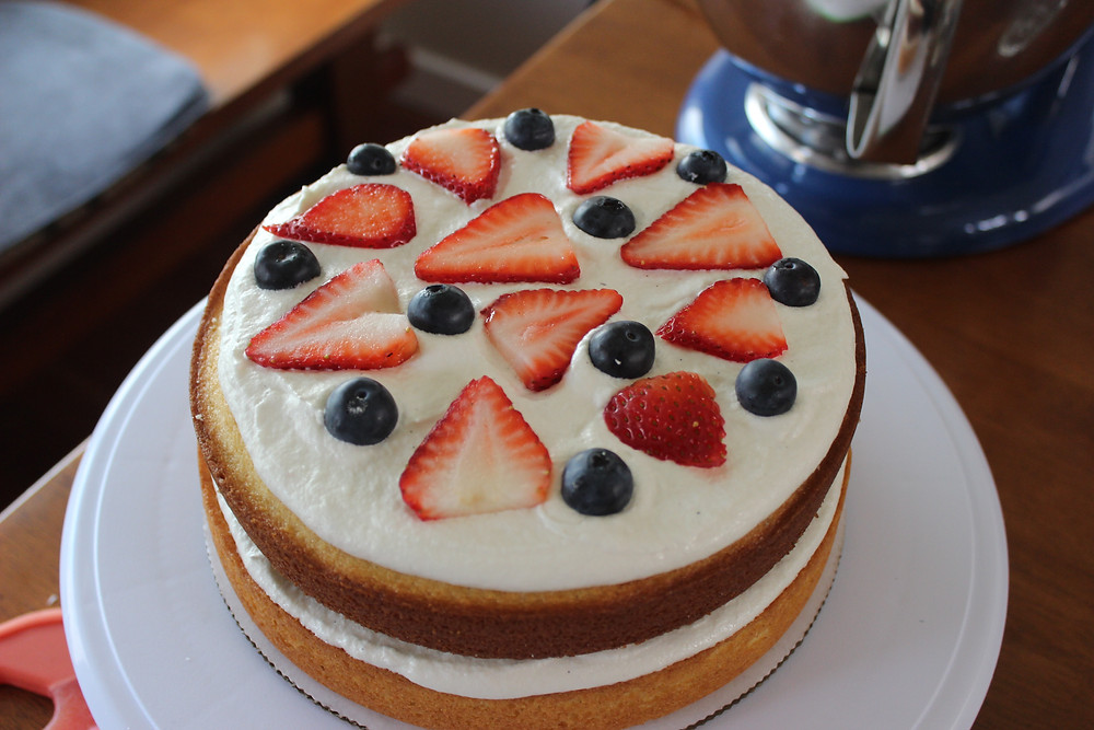 second layer of frosting and fruit