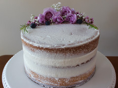 Naked vanilla cake with berries