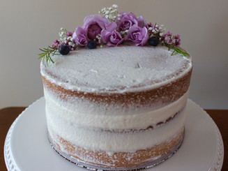 Naked vanilla cake with berries