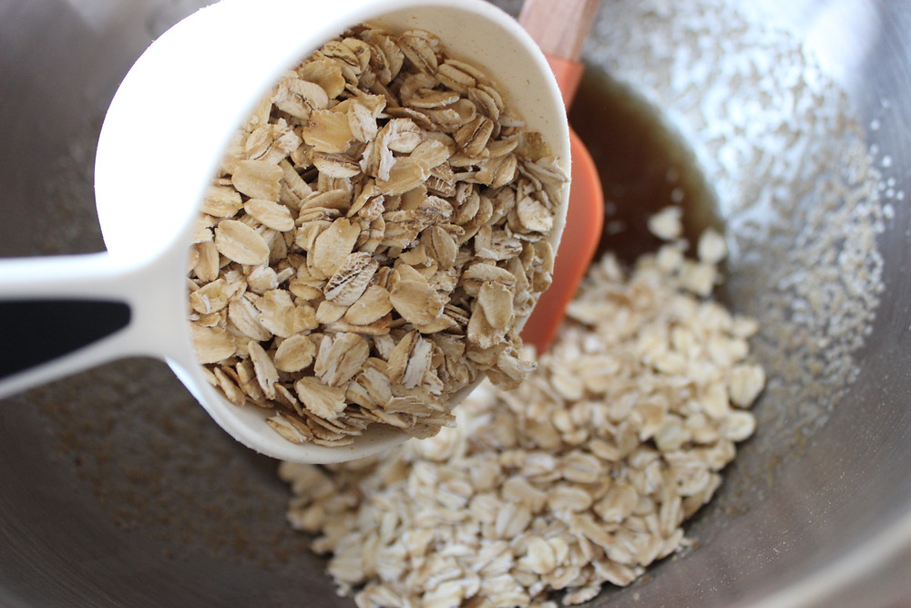 adding oats to oil mixture