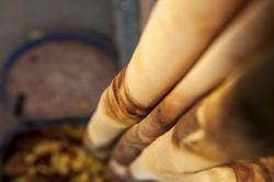 drape of walnut dyed Crêpe de Chine