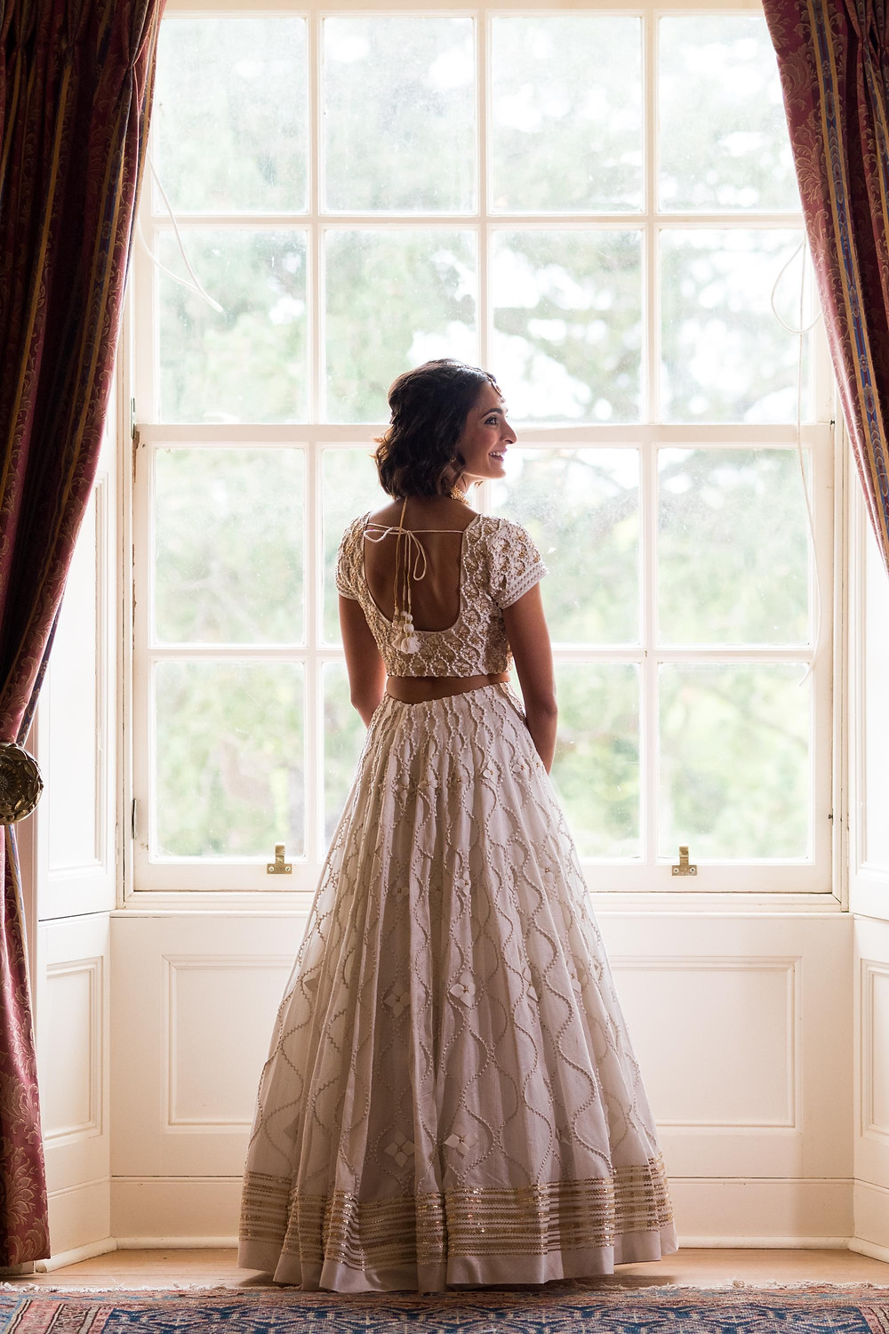 Bride Standing a wedding before a Scottish Country House Wedding with the most beautiful wedding dress ever. John Nassari