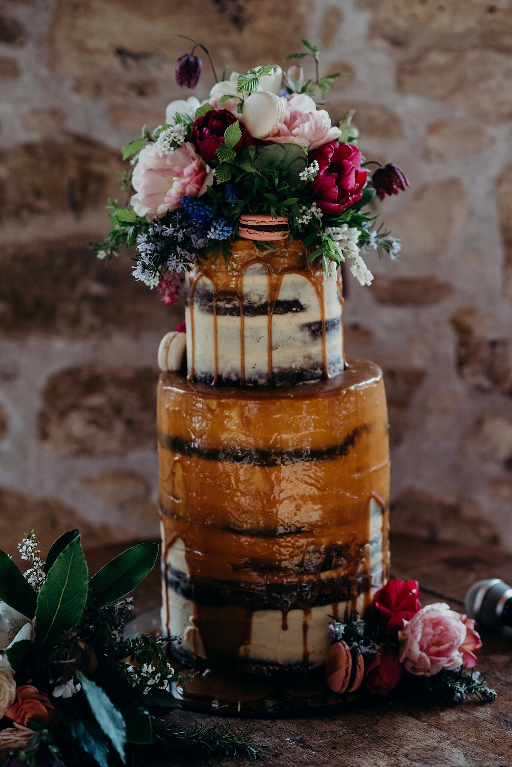 tall wedding cake decorated with beautiful flowers