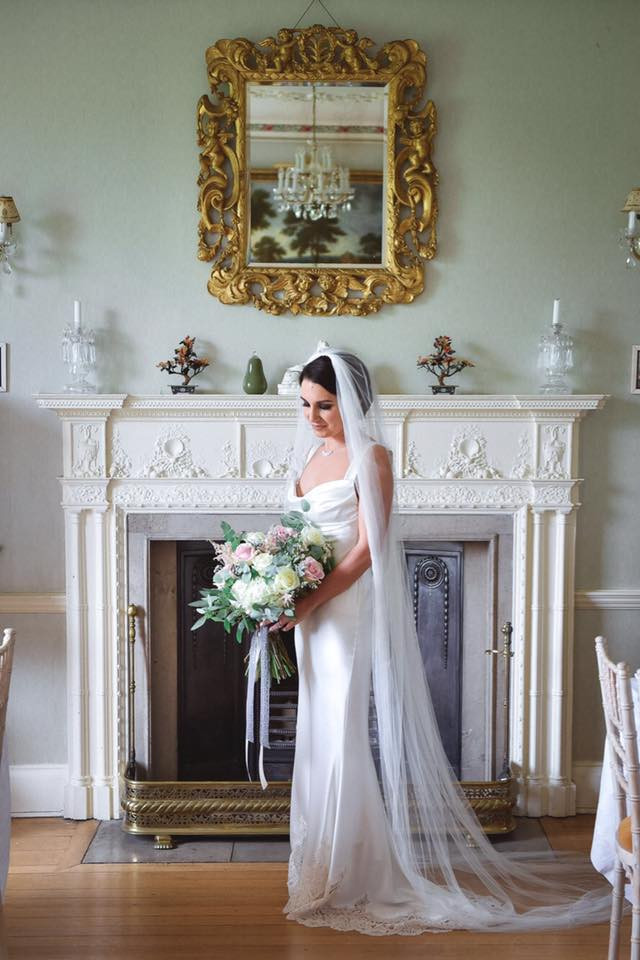 Stunning Bride Standing in the drawing room at Colstoun East Lothian. Photo property of Morgan & Rose