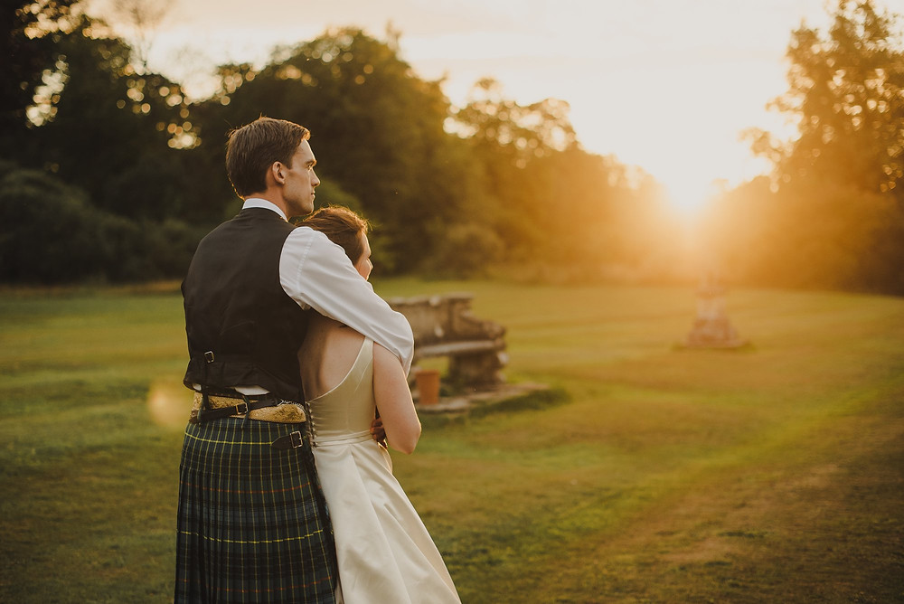 Romantic Scottish Wedding Scene of Bride and Groom watching the sunset