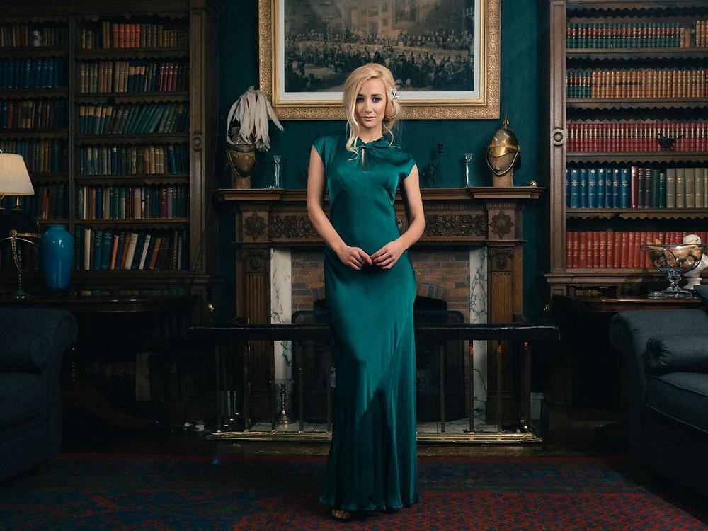 woman wearing long green dress in Colstoun Library