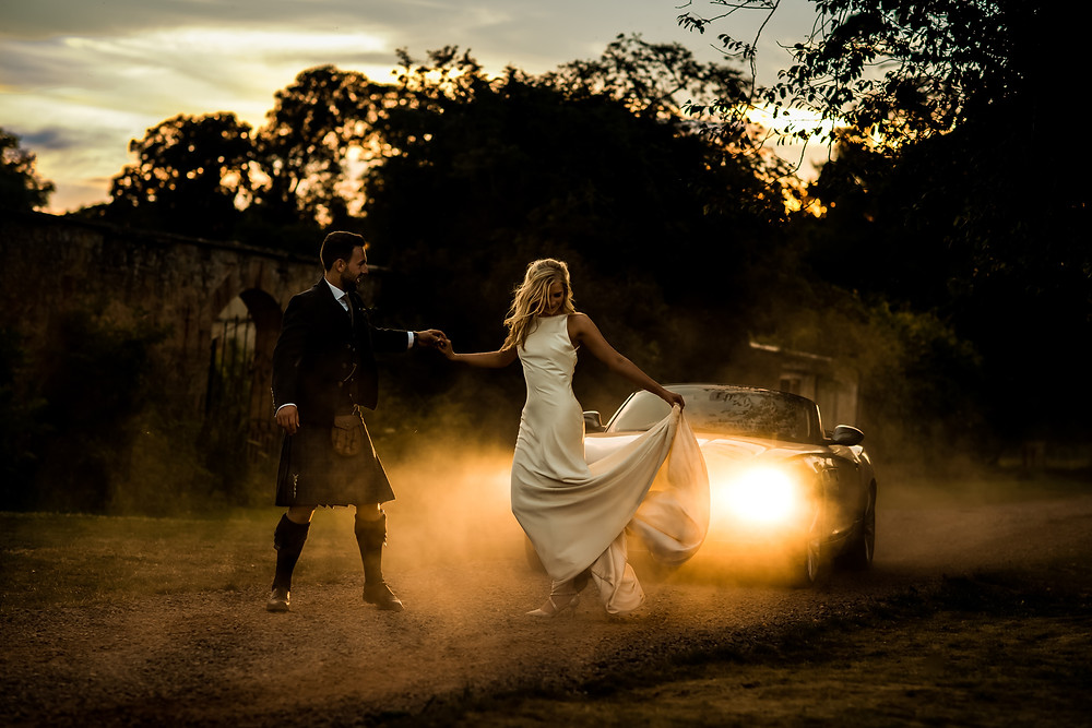 Cinematic Scottish Wedding Photograph in front of car in East Lothian