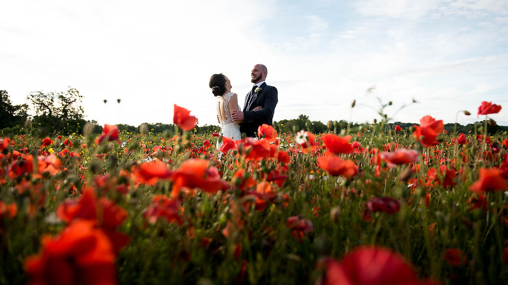 Scottish Couple Embracing in a wild meadow at Colstoun House Scottish Wedding Venue