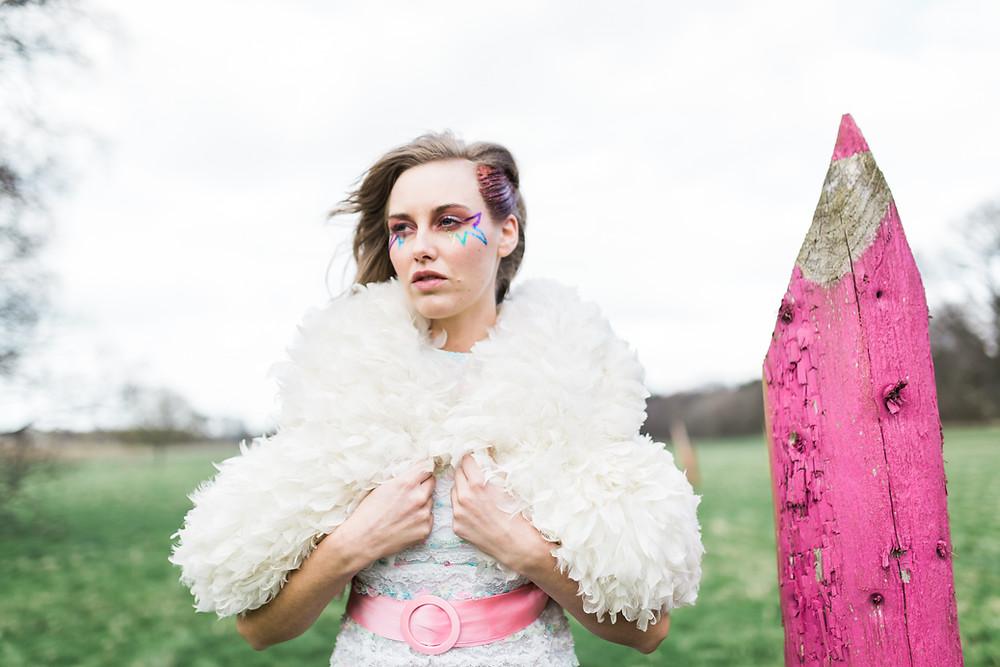 alternative bride in vintage wedding dress next to oversized pencil