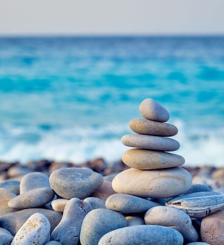 zen-balanced-stones-stack-on-beach-zcq2e