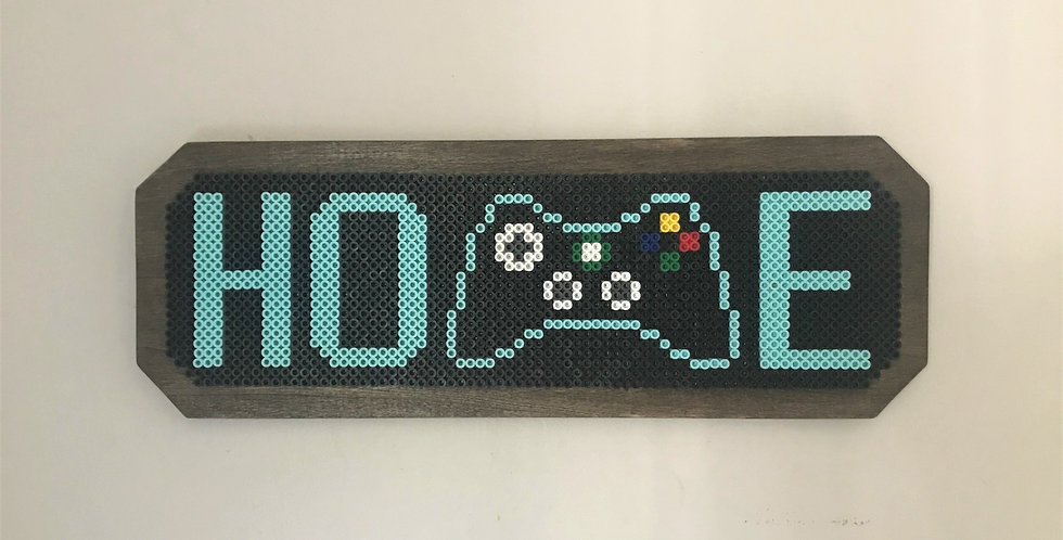 Pixelated Home sign with X Box controller