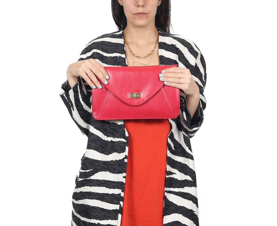 Woman holding clutch purse