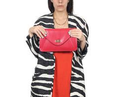 Woman holding clutch purse