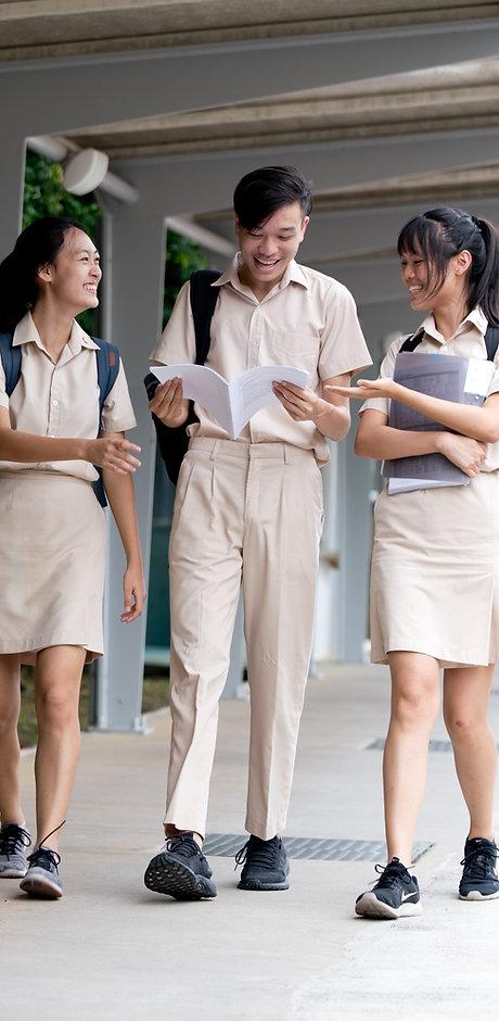 3 students full U walking down slope.jpg