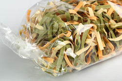 Fettuccine in Cellophane.jpg  Uncooked Spinach and Tomato Fettuccine