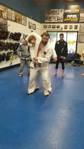 Coach Nick teaching the Kouichi Garuma (Judo shoulder throw) with partner Coach Chance.