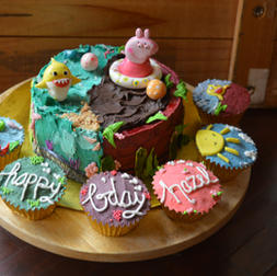 peppa pig cake and cupcakes
