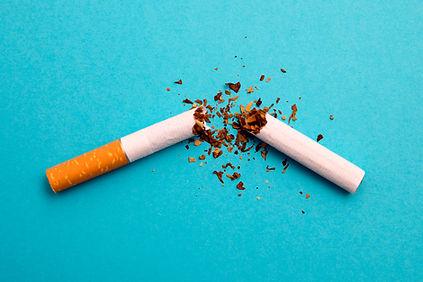 broken cigarette on a blue background.jp