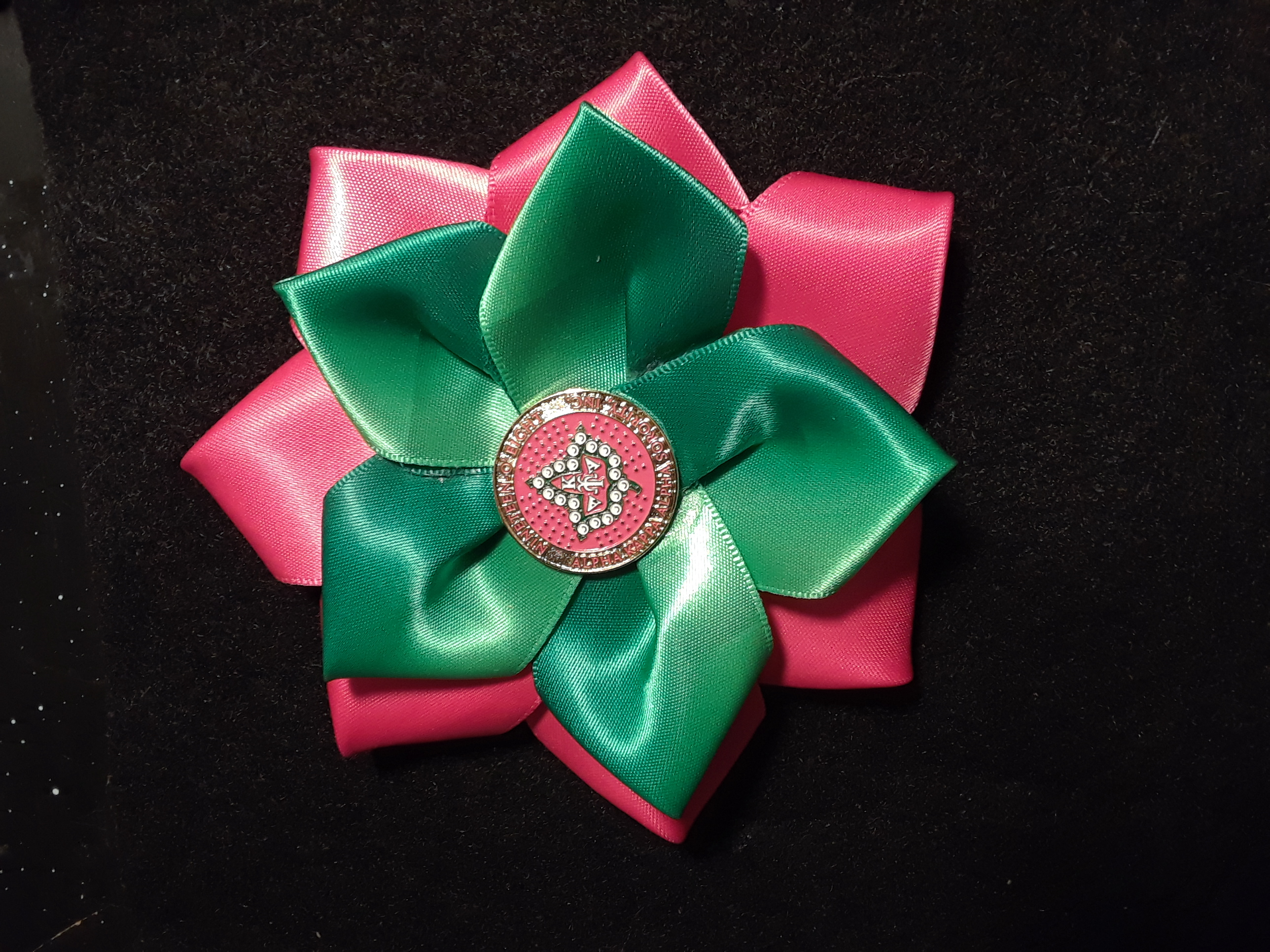 G/P flower badge