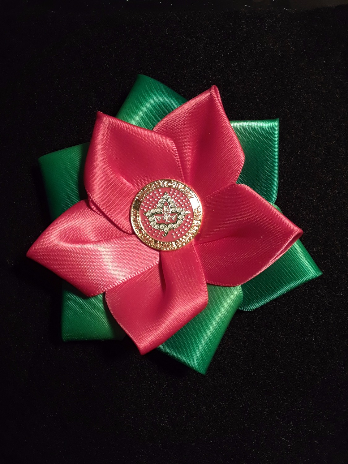 P/G flower badge