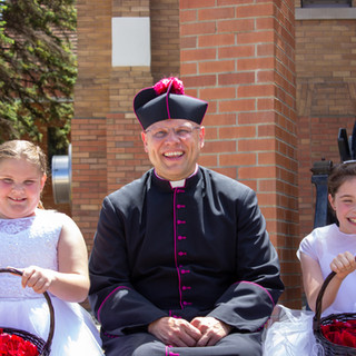 Macy Sherman and Renee Blanco with Monsignor Richter