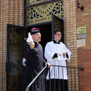 Monsignor Richter and Deacon Paul Gardner Preparing the Crowd for the Procession