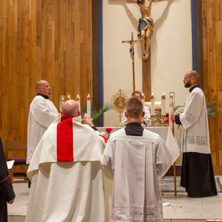 Monsignor Richter, Father Ben Franchuk, and Seminarian Isaiah Jilek Adoring Blessed Sacrament