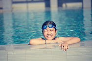 Happy girl swimming in pool