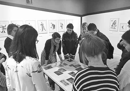 Alexandra Chiriac teaching students in an exhibition