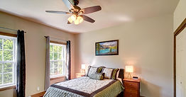 Master Bedroom, hardwood floors, wood cabinet and night tables, lamp, queen size bed, fenestration, daytime sunlight