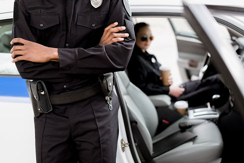 cropped-shot-of-policeman-with-crossed-a