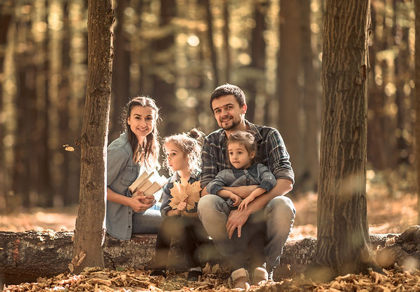 a-young-family-walks-in-the-autumn-fores