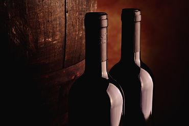 Virginia wine bottles and wine barrels.