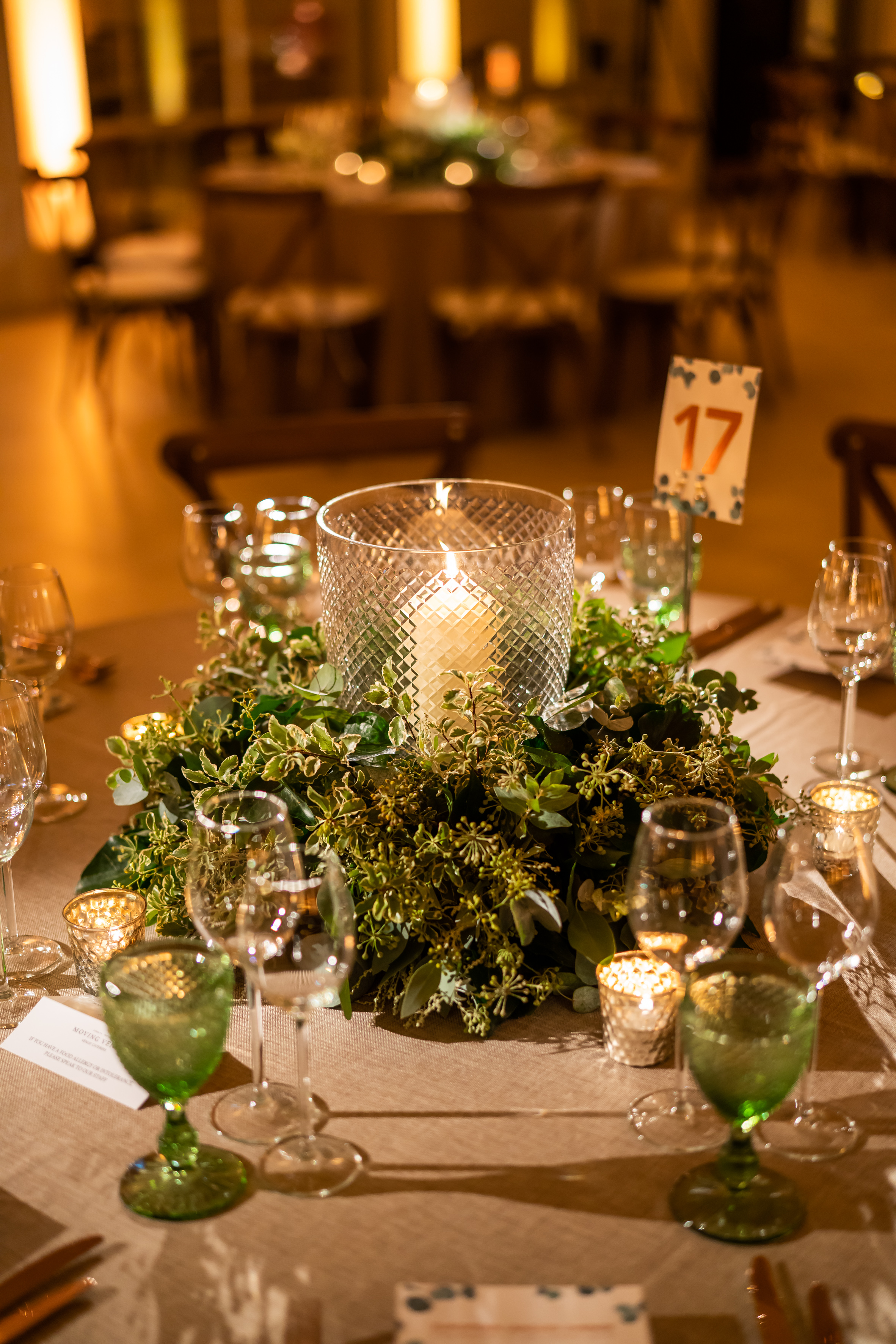 Low foliage lantern table centre