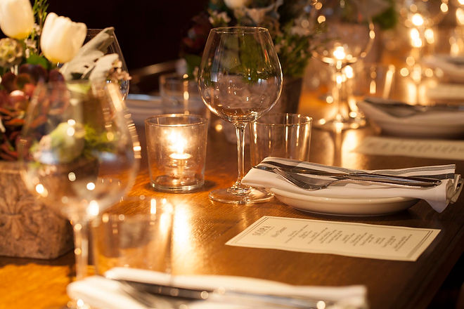 Photo of a beautiful dinner placement at a large table