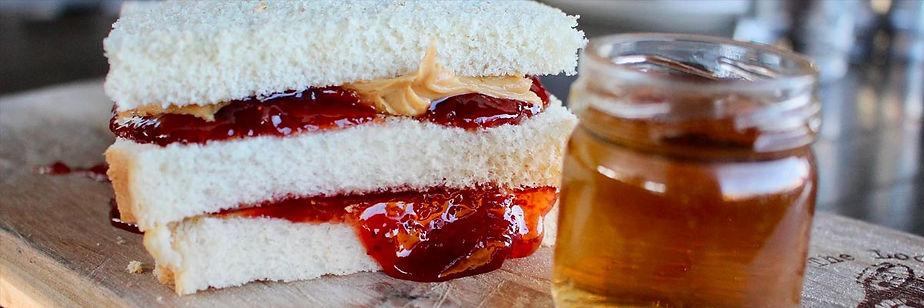 Huge double-decker peanut butter and jelly sandwich
