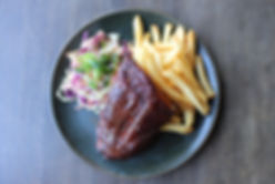 Ribs on a plate with french fries and cole slaw
