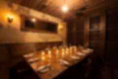 Large table set in private dining room at Black Market Liquor Bar